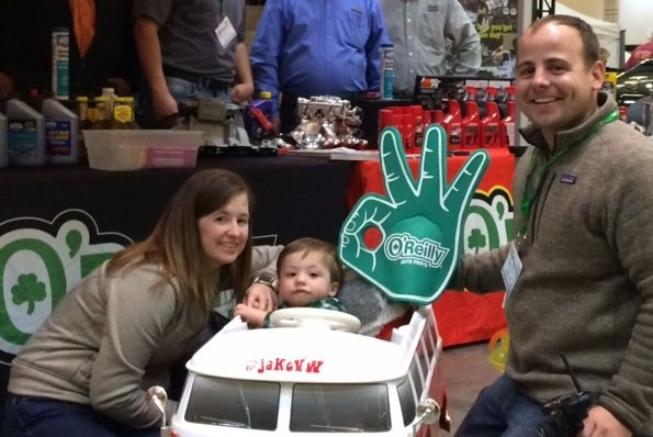 Child in a VW Van push car takes picture with O'Reilly foam finger