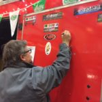 Tom Smith signs O'Reilly Auto Parts trailer